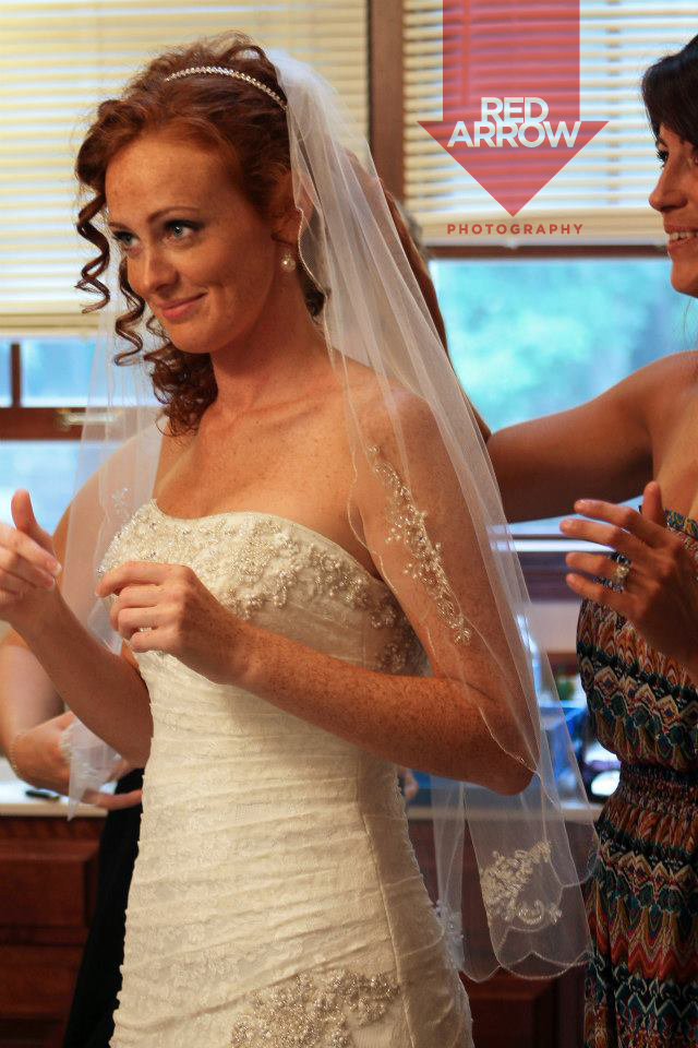 Bride seeing herself for the first time - I think she's happy.