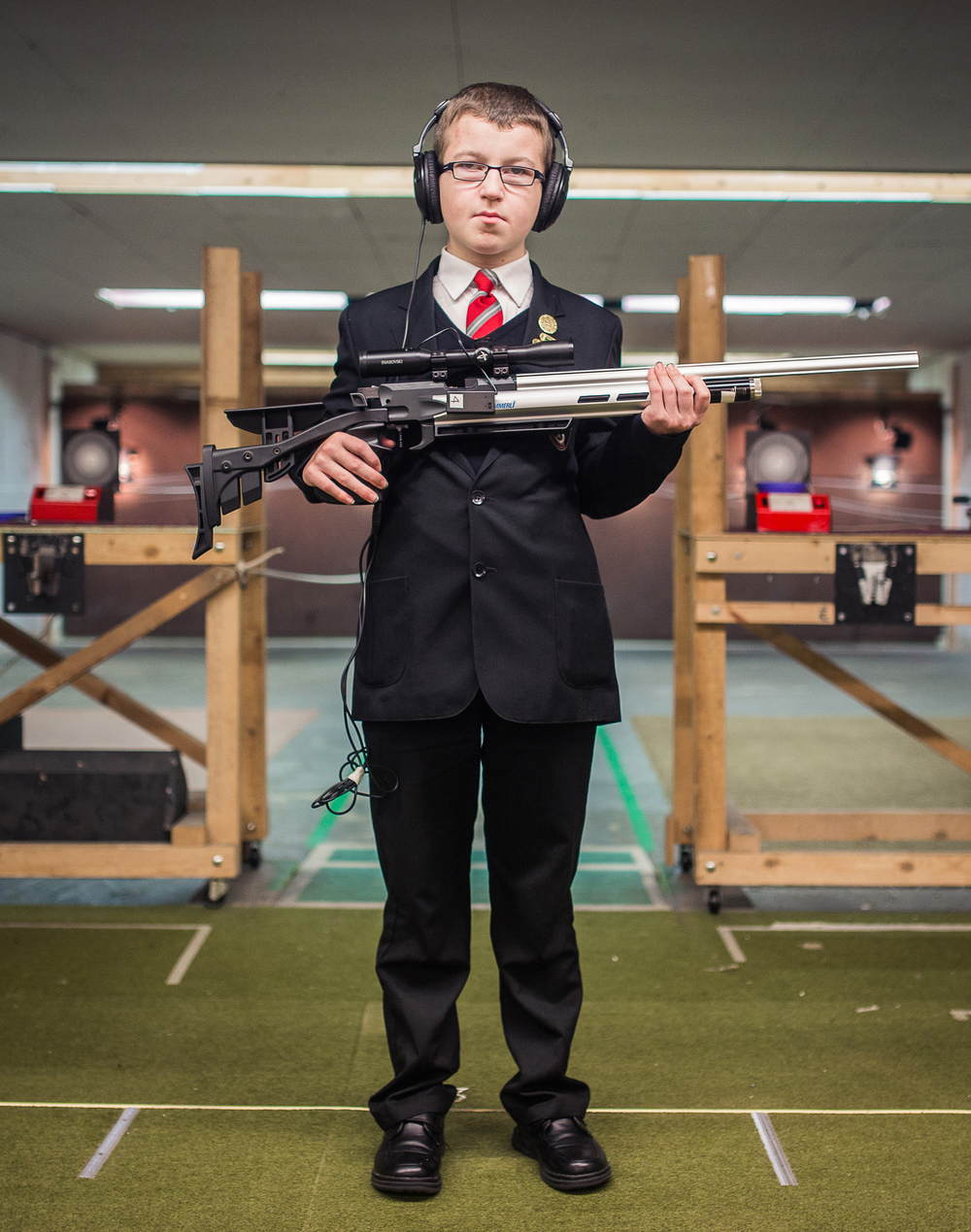 """""""I'm 13 and I shoot at Helston Gun Club. I love the fact that it's all done by sound, you don't have to look at the target to shoot. You find the sound and you shoot. Whenever I've told people at school about it they've all said 'Ah that's amazing, how can you do that with your ears?' My friends call me Top Gun.""""  Haydn, Blind Shooting, Helston Rifle & Pistol Club, Cornwall"""