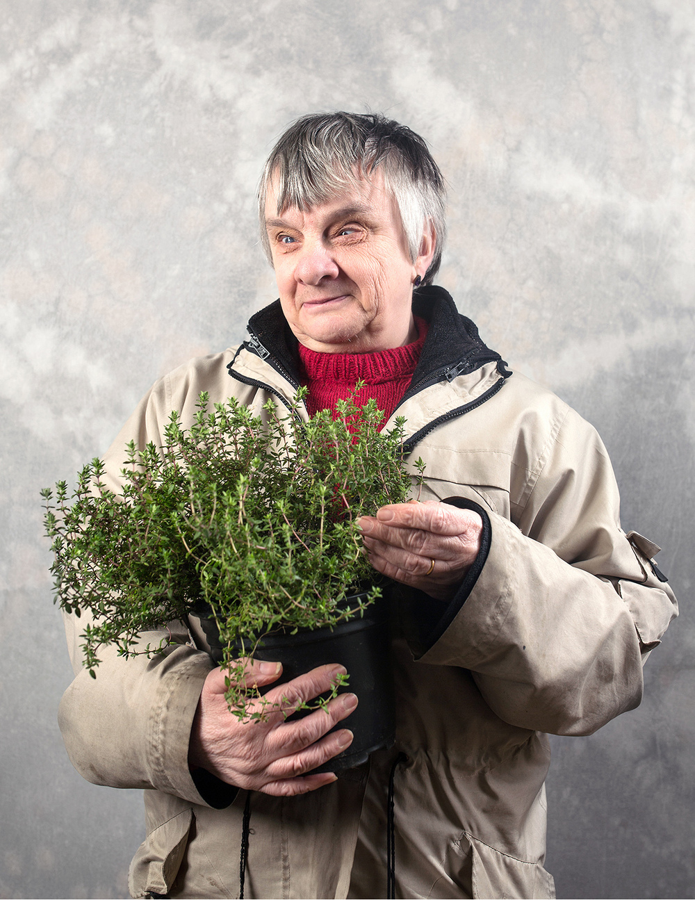 """""""I had sight until I was about 32, and then I lost it. The gardening is great, it's hands on and I get to meet people. At the moment we're planting cuttings of herbs, and I am interested in herbs. There are so many services that have been cut by the council; these clubs make a lot of difference. They make me go out and mix with other visually impaired people which is really important. I like meeting people and coming here, and I do also learn things. At Christmas we do a garland, which is lovely because you can hang it up on the door. Andrew [tutor] showed us the onion sets we planted, and they've certainly grown. It would be good if we could see the real thing, this time they had leaves on.It's very important really to get out and see a bit of nature as it should be, you know?""""  Sylvia, Blind Gardening Club, Camborne, Cornwall"""
