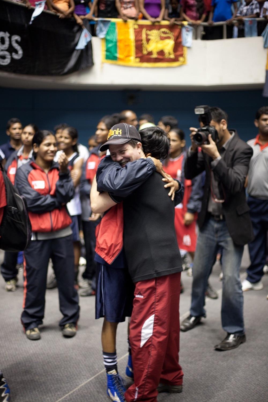 Anusha hugs Cuban coach Julio Concepcion Santana Padron (© Lee Bazalgette)