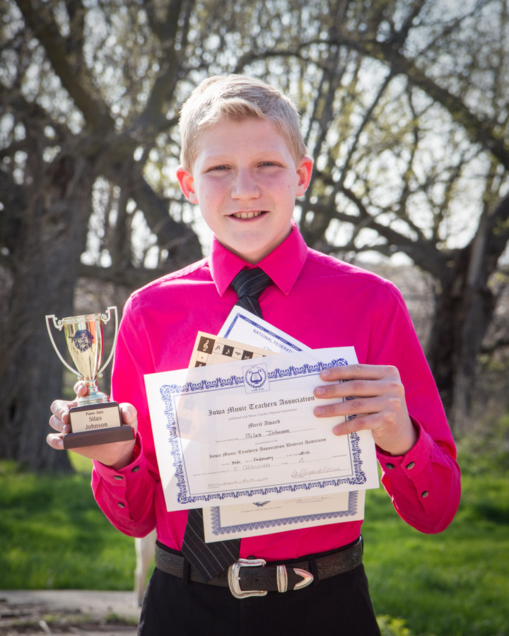 Silas with this school year's piano awards!