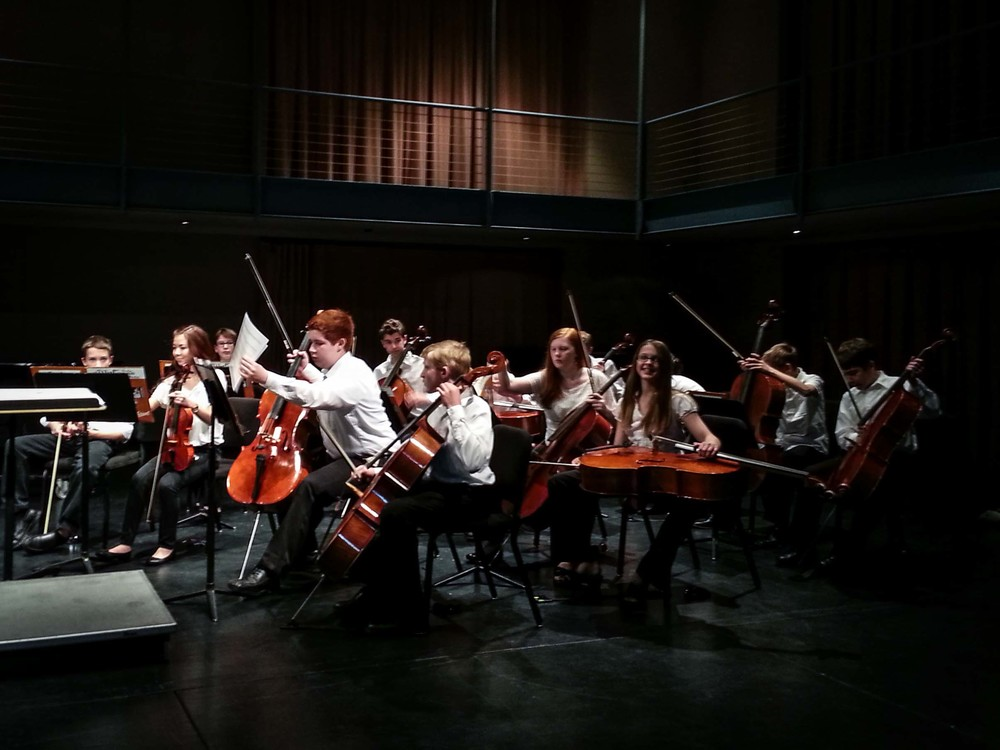 "Silas warming up with the Northern Iowa Junior Orchestra after their tour, and before their spring concert in Davis Hall at the Gallagher Bluedorn Performing Arts Center. He is first chair cellist out of 11 cellos! This year, one of the pieces the orchestra performed was Saint Saens ""Carnival of the Animals"". So, Silas got to play ""The Swan"" as a solo during the concert. He did a fantastic job!"