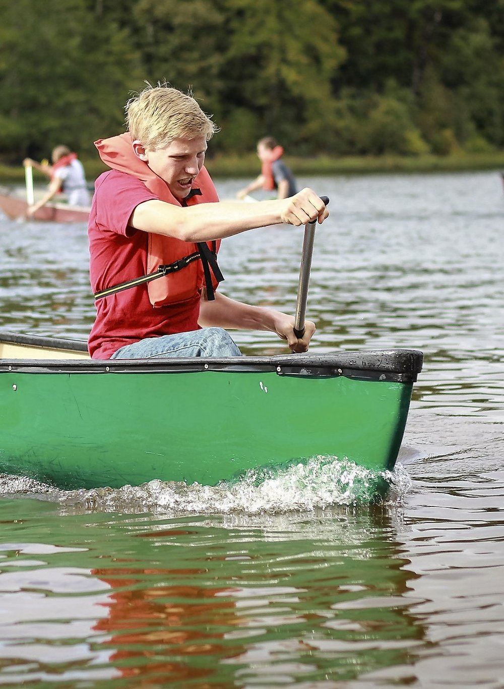 Silas in the bow of his and Laura's canoe - capturing second place for their canoe race!