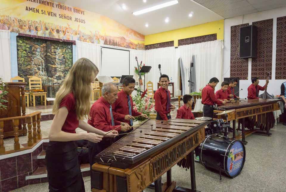 The Guatemalan churches were delighted to share their music with us in return! Here Laura was invited up to try her hand with the marimba ensemble!