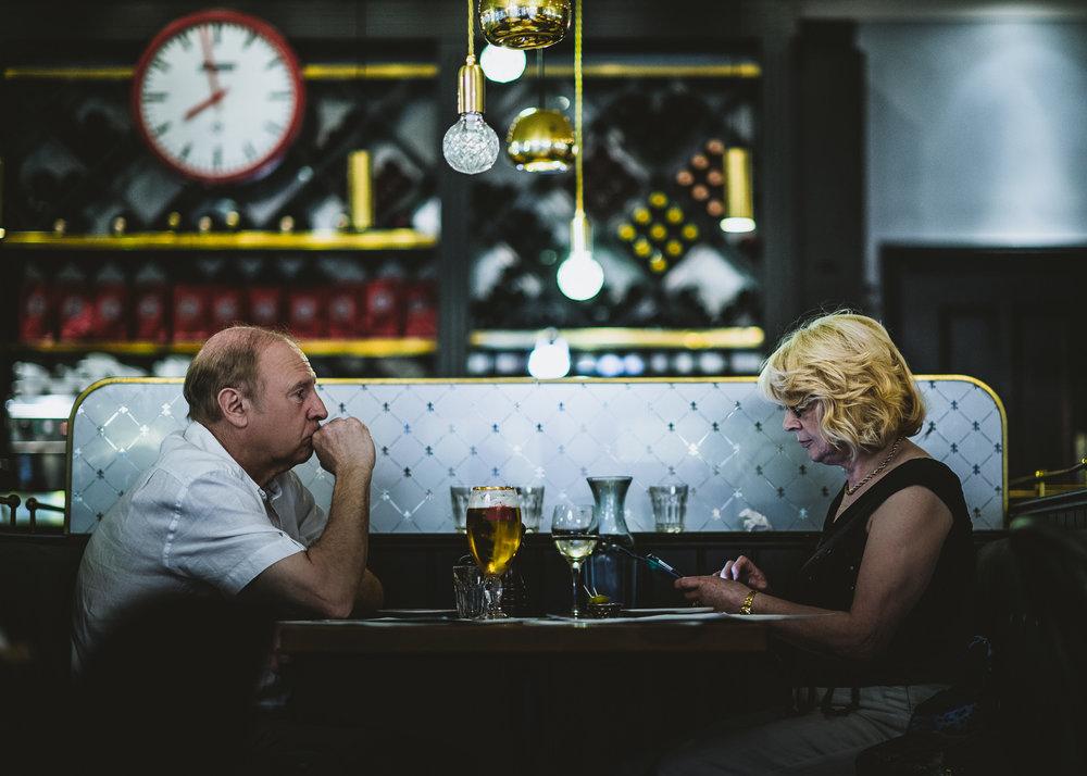 Couple sitting at a restaurant in Birmingham.