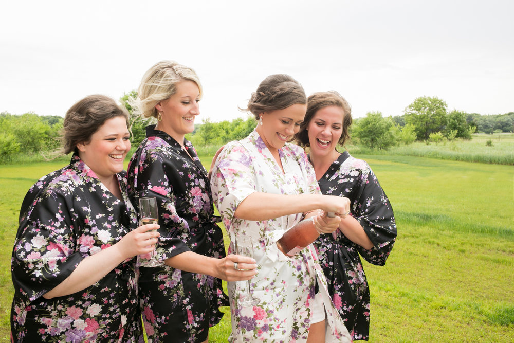 bridesmaid robes and champagne