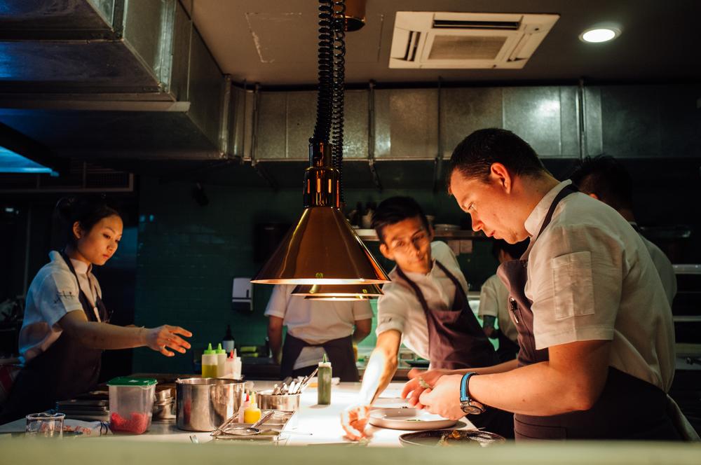 Paul Gajewski (far right), at Tippling Club's open kitchen
