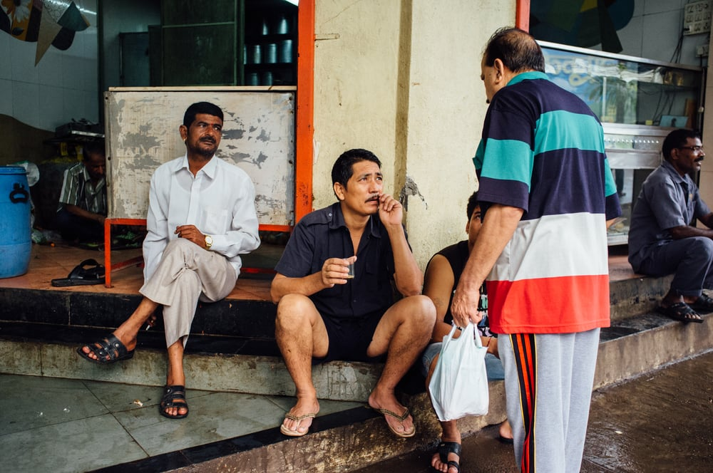 Morning scene outside Sankar Lal's tea stall in Thane, Bombay. I like to think of it as my local Blue Bottle.