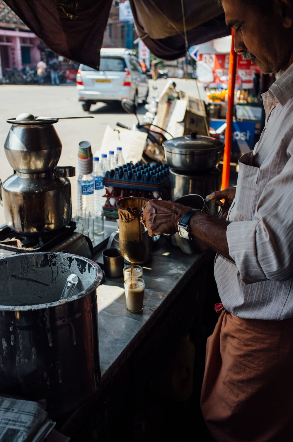 Pouring decoction at a tea stall in Alappuzha, Kerala