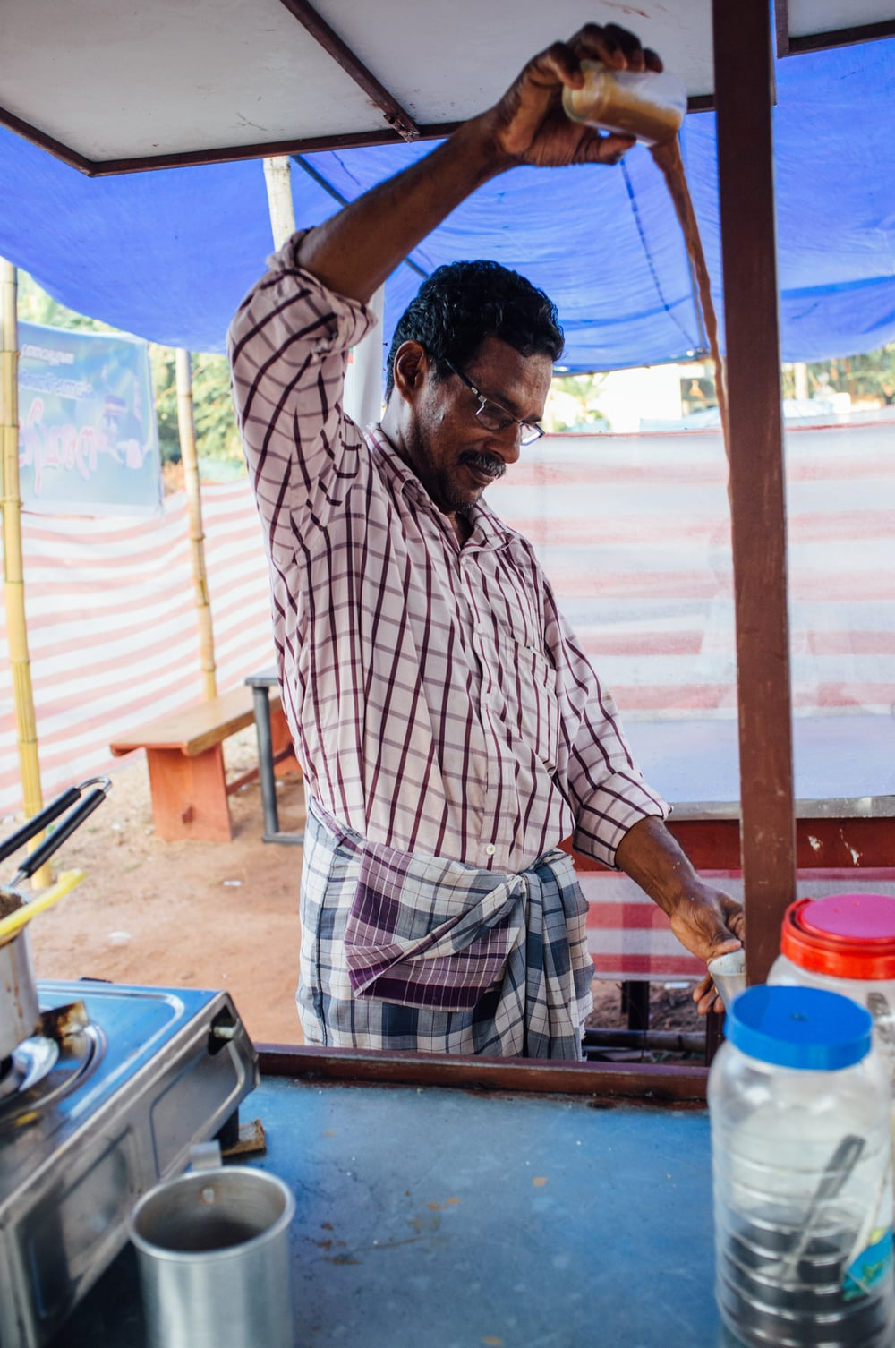 "Roadside tea stall in Kumarakom; tea is often ""pulled"" before being served"