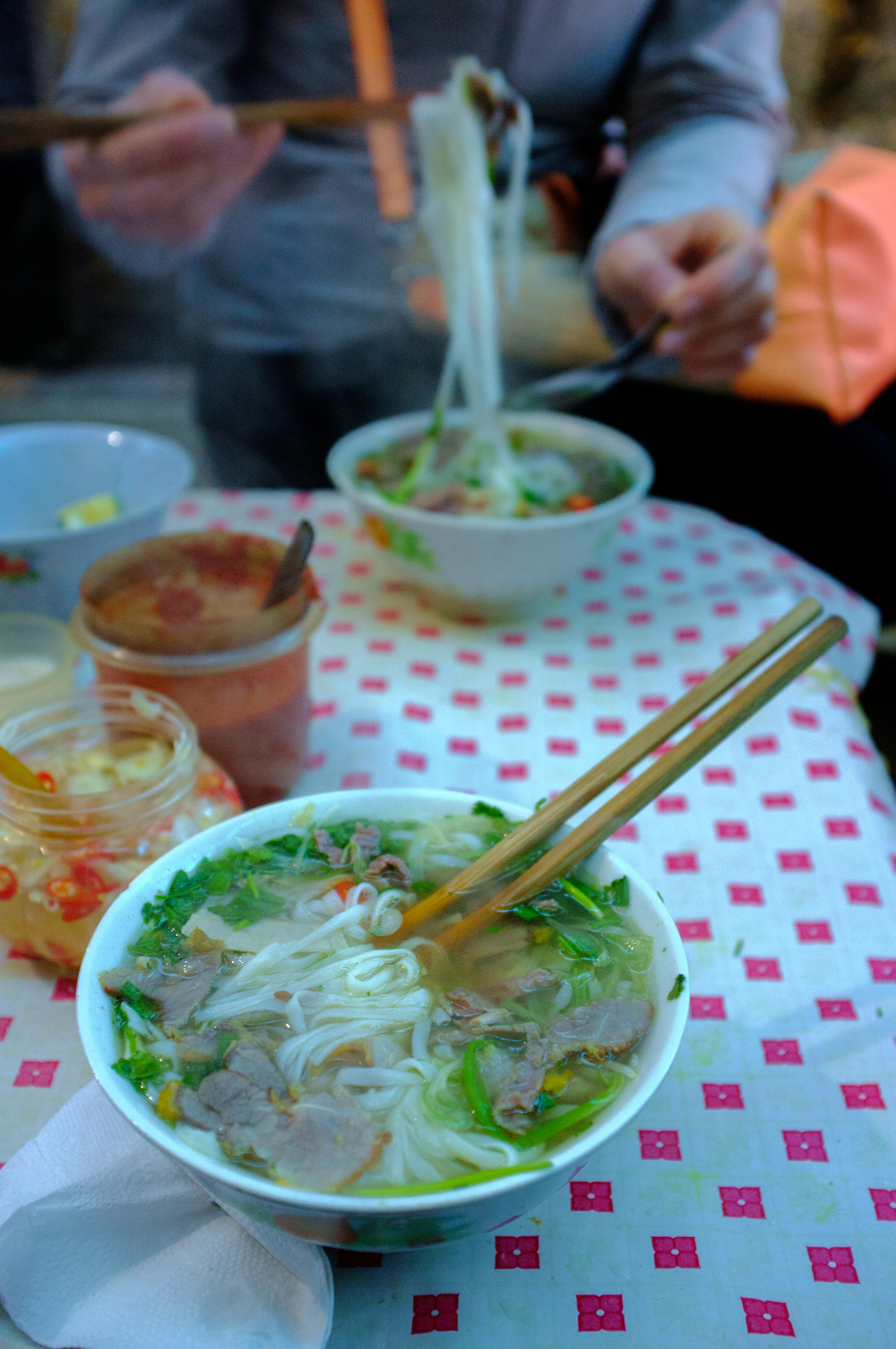Hanoi: enjoying a bowl of  phở