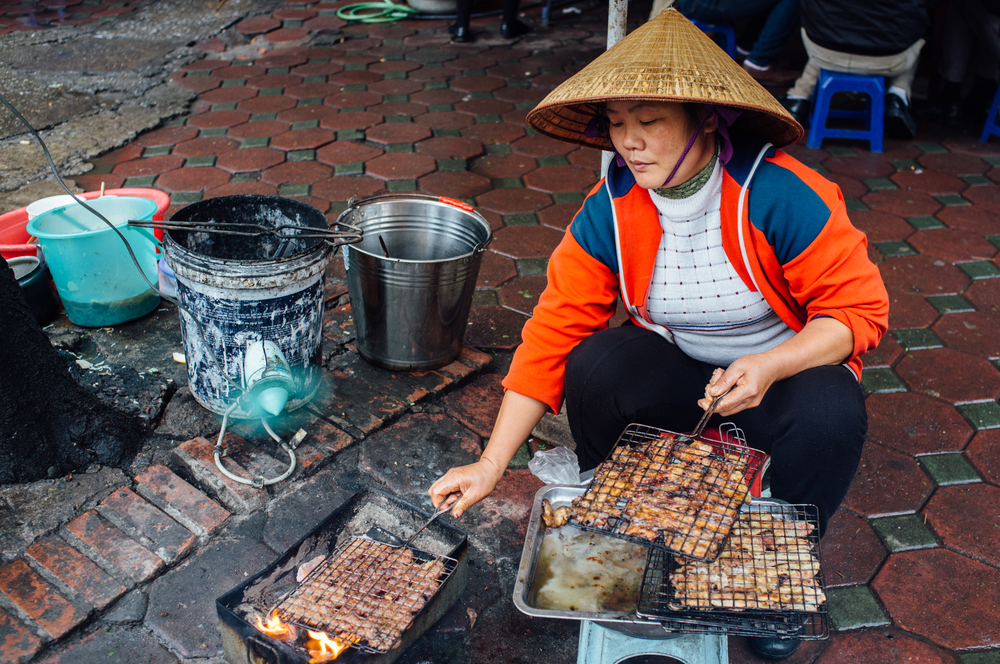 Bún chả prep on the streets of Hanoi. Notice the use of fan.