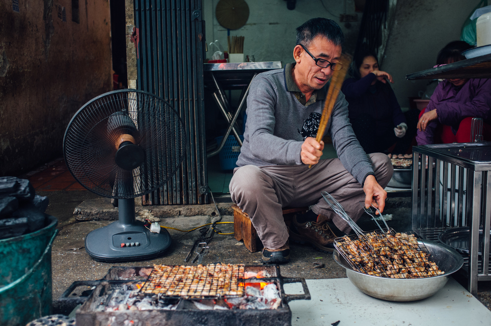 Uncle prepping bún chả on the streets of Hanoi