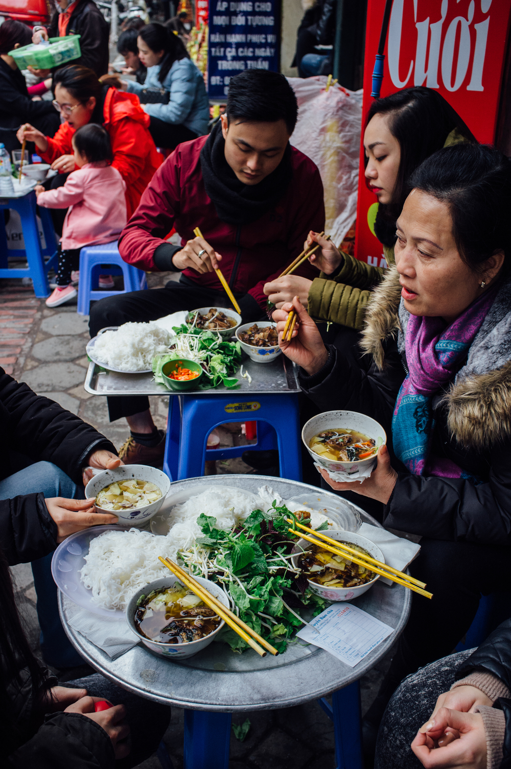 Locals enjoying lunch at Bún Chả Tuyết