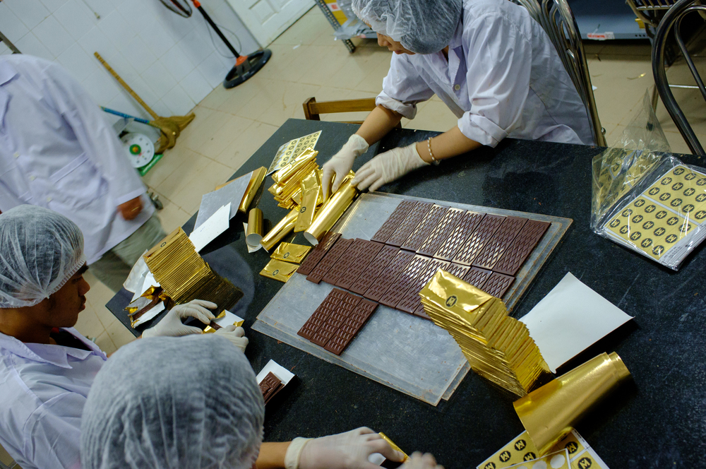 Hand-wrapping each bar