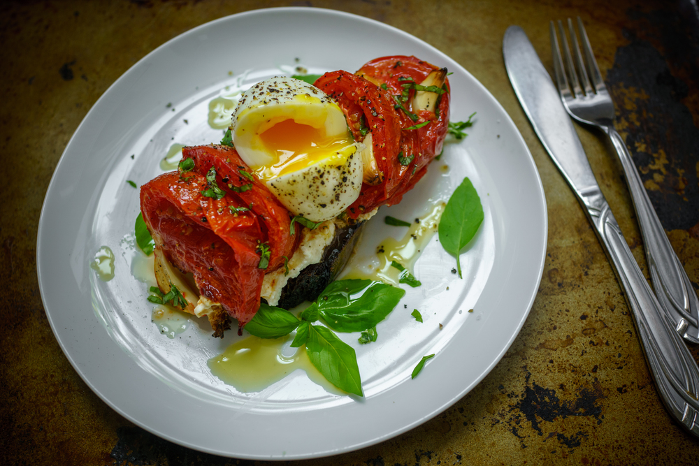 Roasted tomato tartine, topped with a soft boiled egg