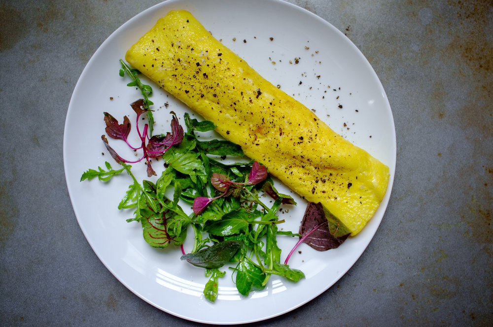 French omelette with mixed greens on the side