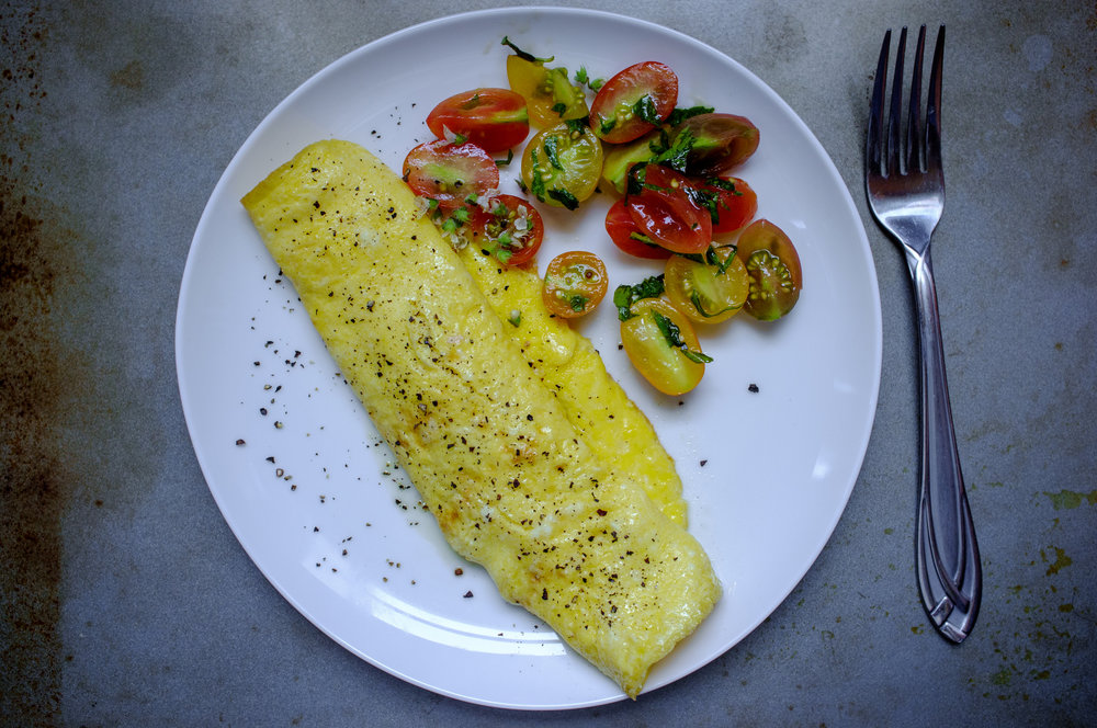 Goat cheese omelette with tomatoes and herbs