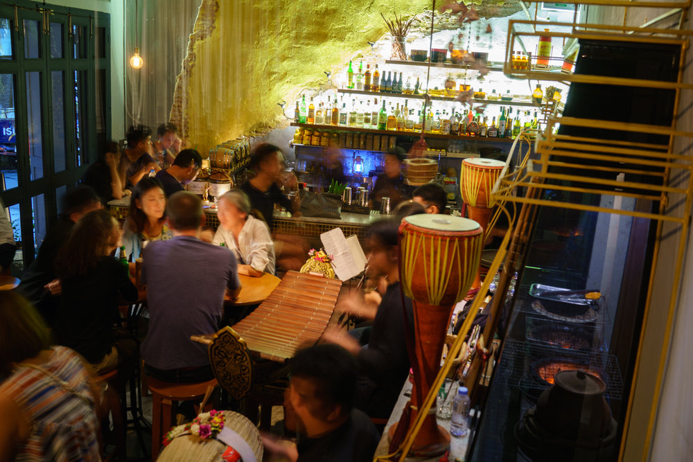 Aerial of Tep Bar guests and live traditional music