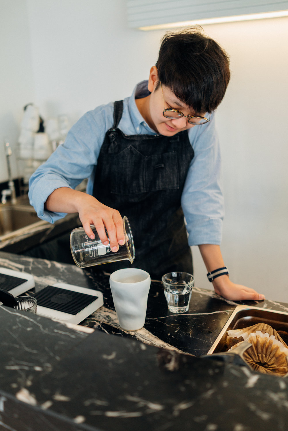 Pouring coffee at Hands and Heart