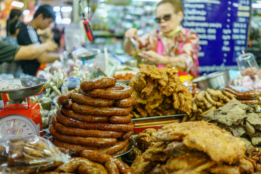 Sai ua auntie presiding over her stand at Warorot Market in Chiang Mai