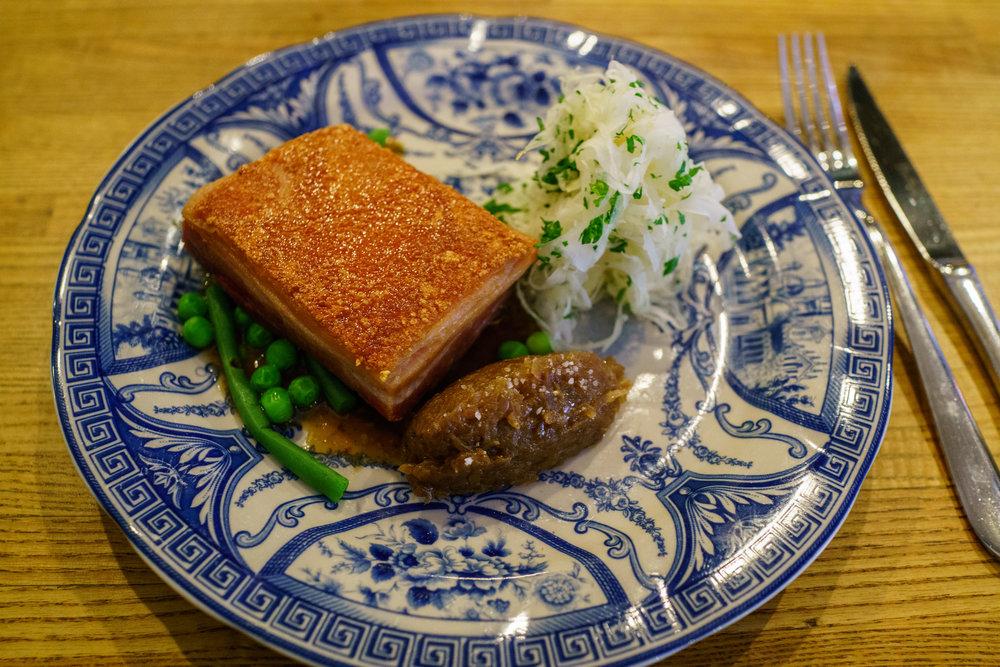 Pork confit with cabbage, beer braised onions & roasted garlic at Rolfs Kök, Stockholm