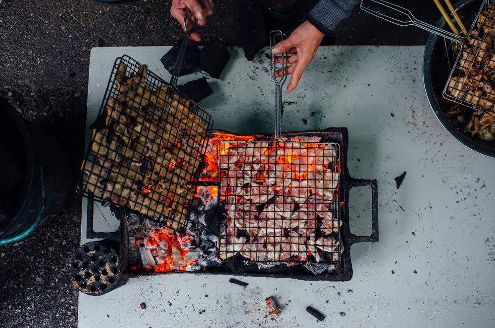 The charcoal grilling begins hours before lunch service