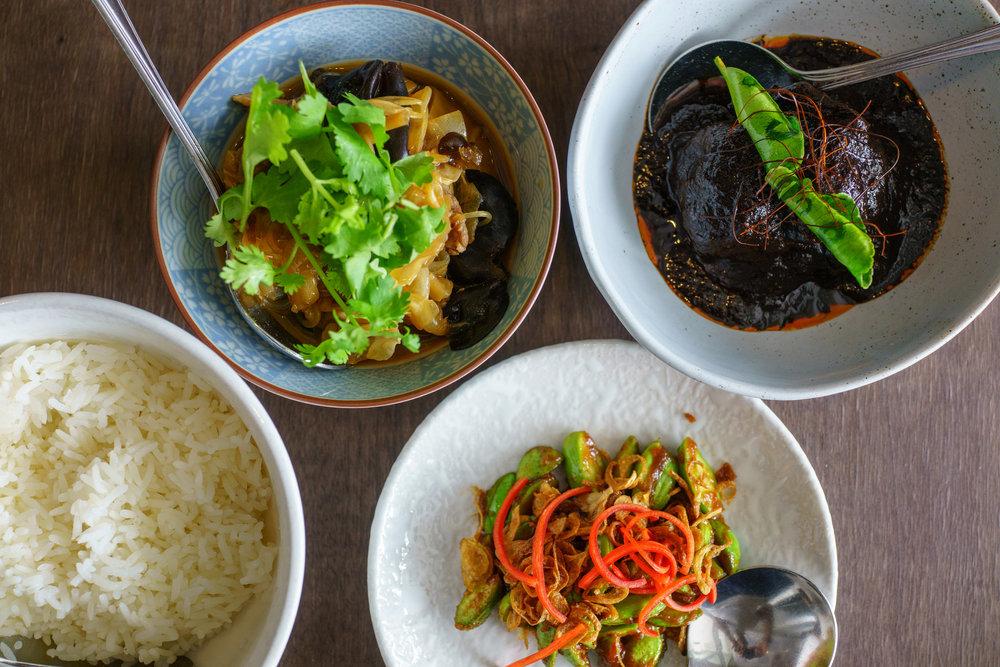 From top left, clockwise:Chap Chye,Buah Keluak,Sambal Kacang Petai, plain rice