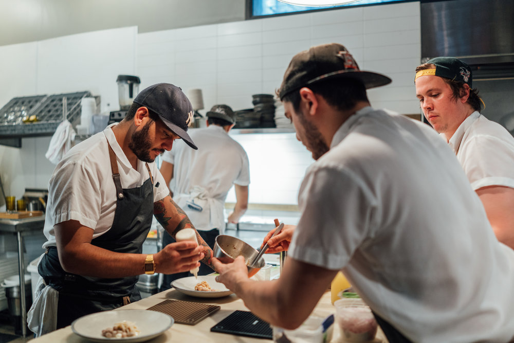 Sous chef Diego and his team at the kitchen in Contra, New York City