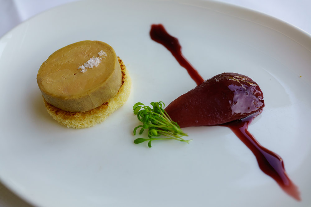 Foie gras torchon, Croatian red wine reduction, pear, and brioche at Bistro Apetit