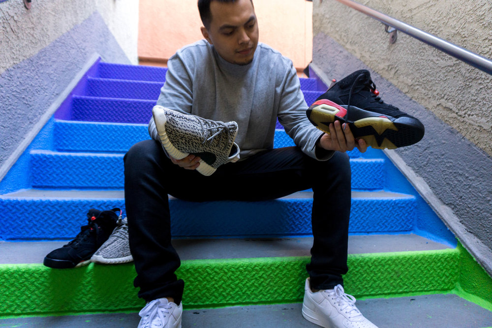 Eric Cachua looking at sneakers