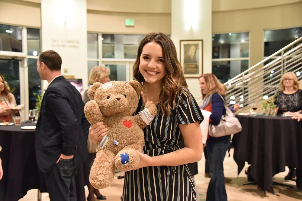 Madisen Dewey holding the CHOC bear
