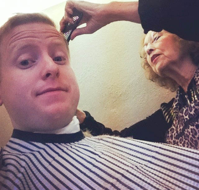 AP employee getting a hair cut
