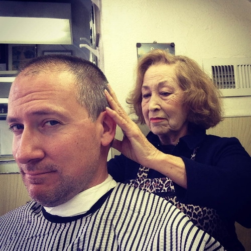 Steve Harbour getting a hair cut