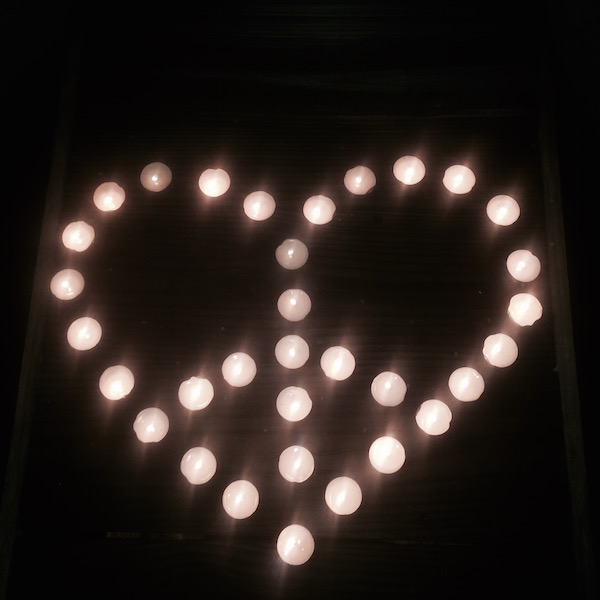 My friend Kaitlin held a vigil with 33 candles on a beach in Florida for the crew of the El Faro.