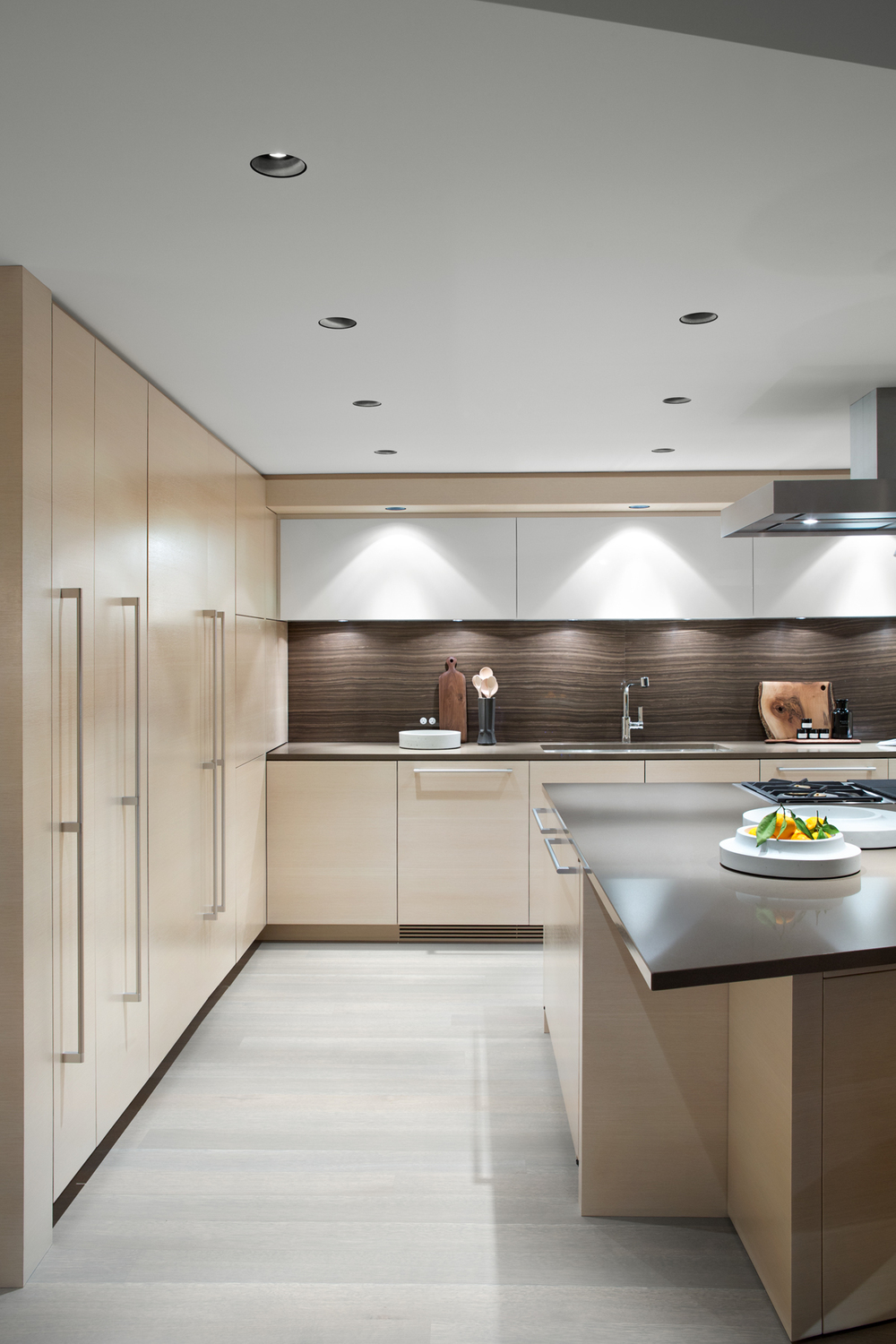 As part of the custom millwork, all appliances are integrated and invisible, which creates a minimal and quiet effect.