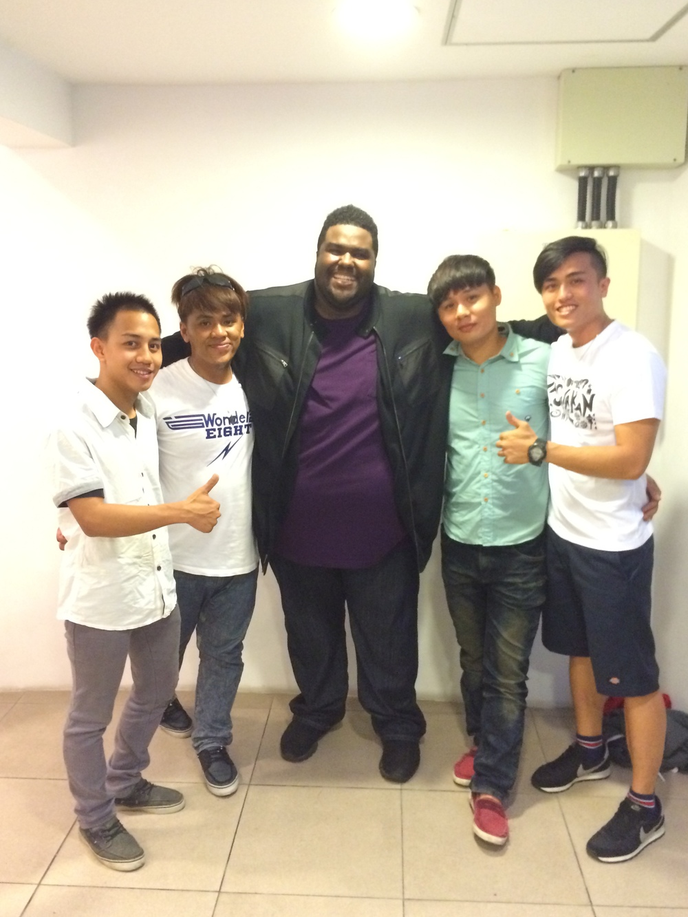 Chinua Hawk and the band backstage at the Taichung Amphitheater