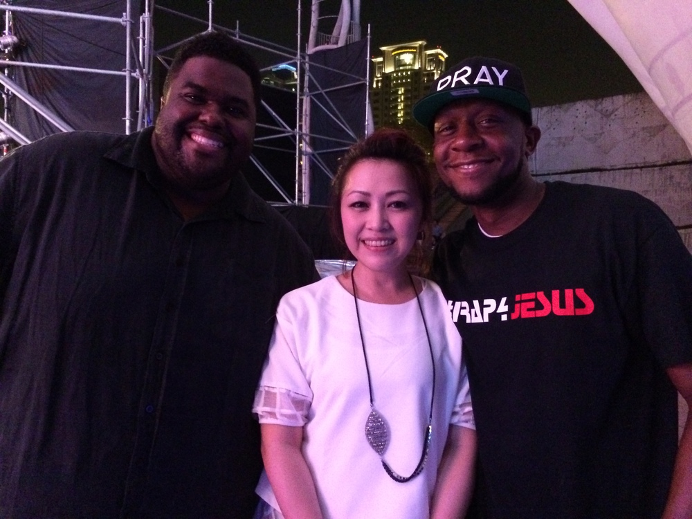 Chinua hawk backstage with recording artists Obie One Ba and Taiwanese recording artist.