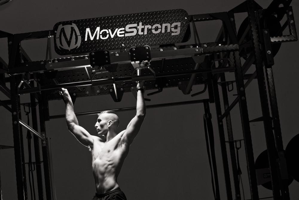 MoveStrong_marketing image-4_B&W monkey bars.jpg
