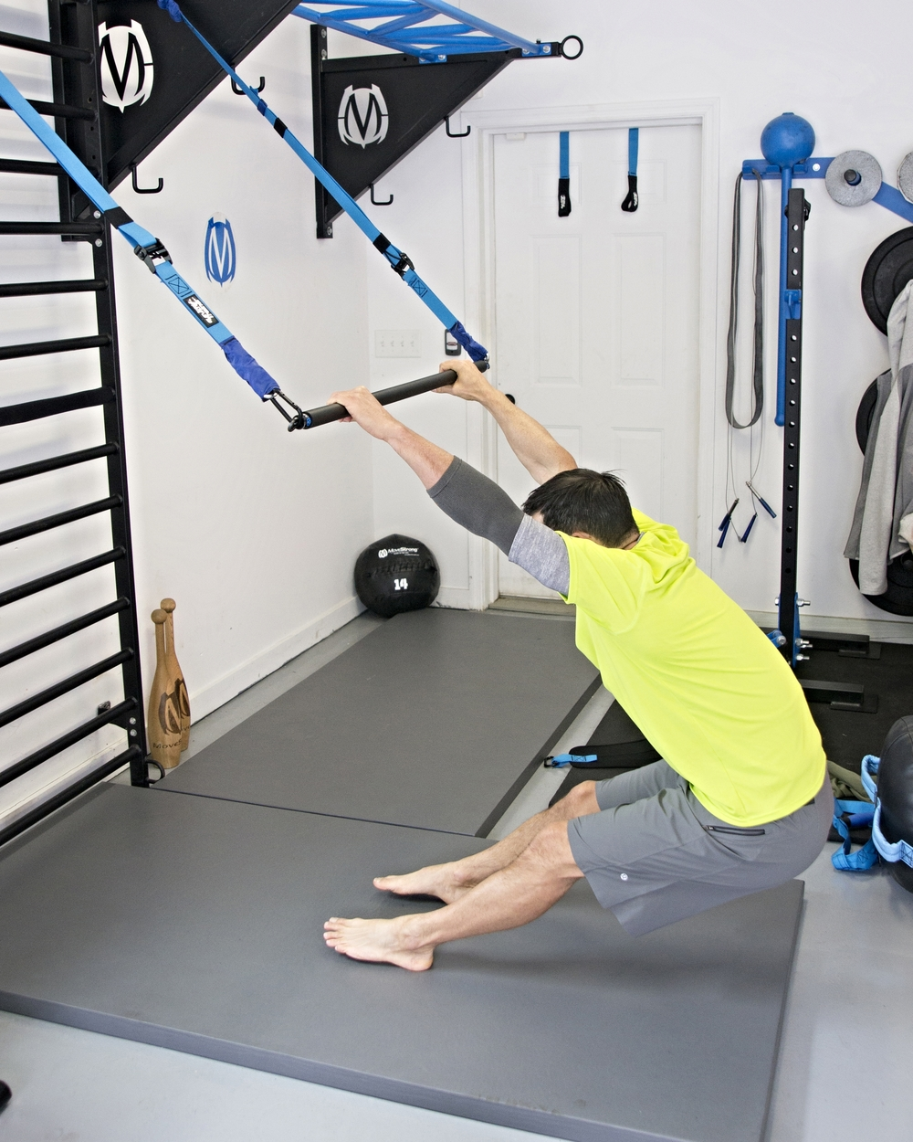 Elevate suspension bar mobility exercise