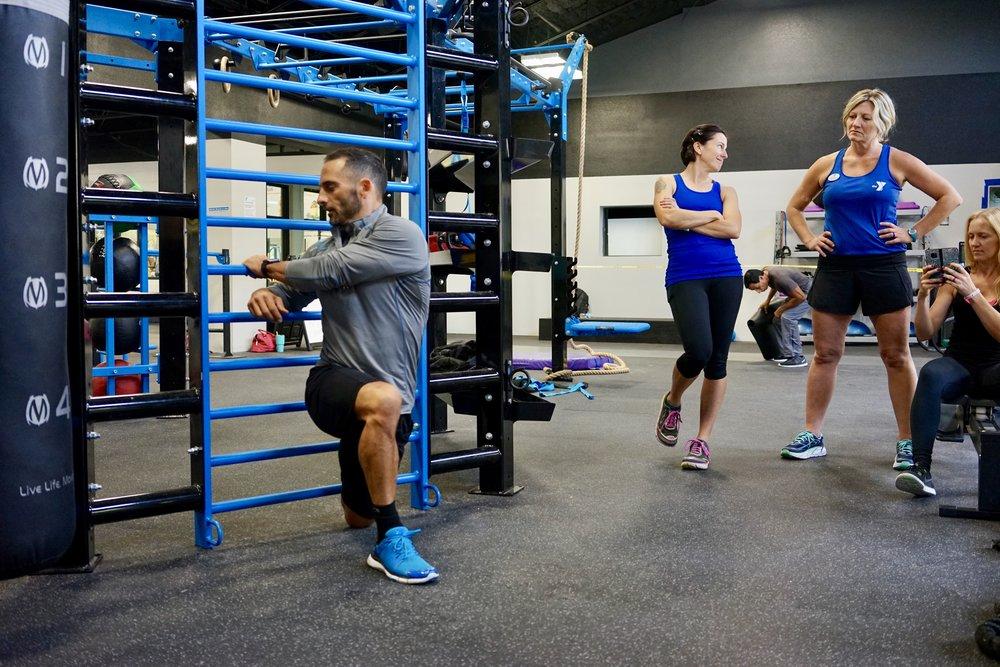 Stall bars quad and hip flexor stretch