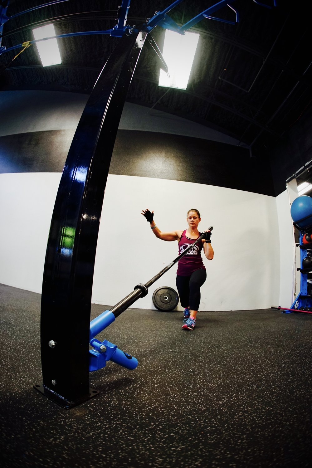 Ground Rotational Trainer lunge to press