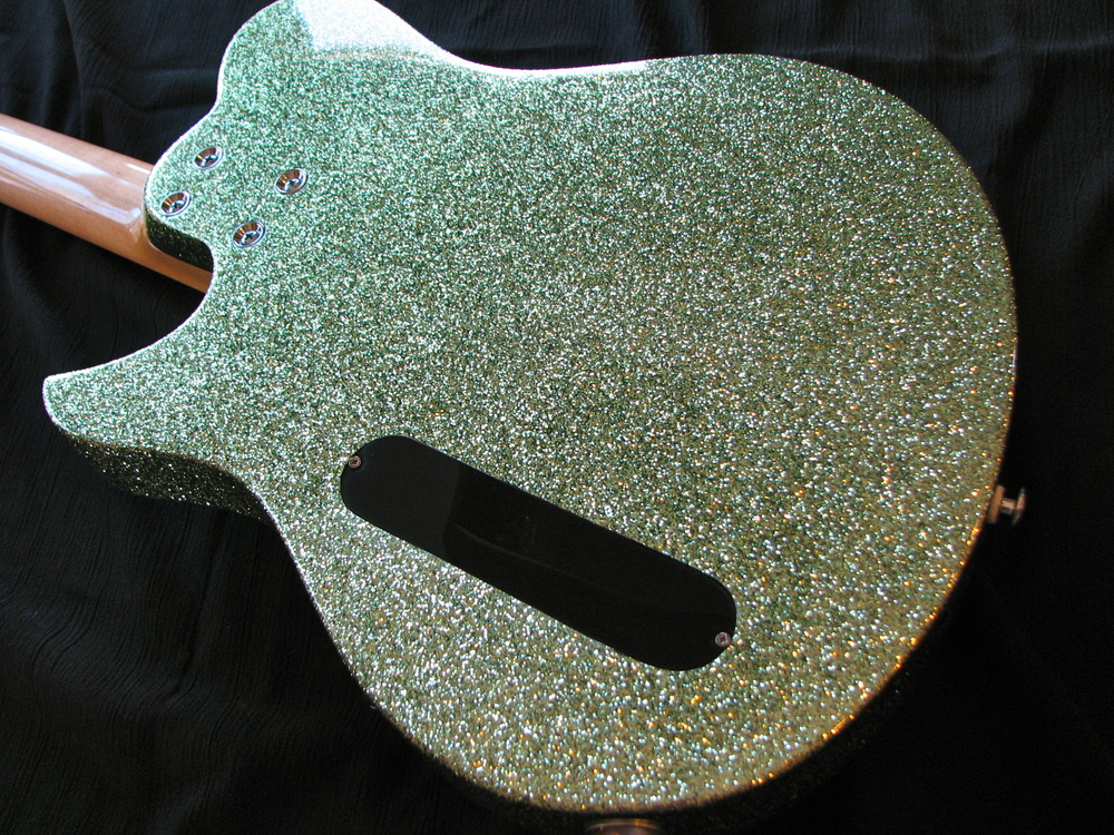 The body is alder with a lime-green sparkle finish