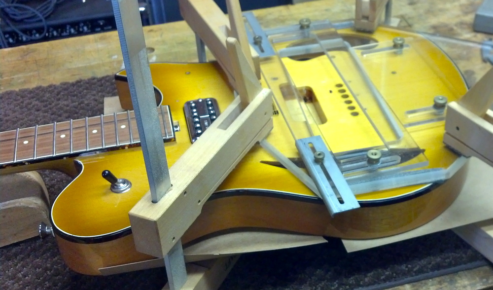 The owner of this beauty wanted a piezo pickup added under the bridge.