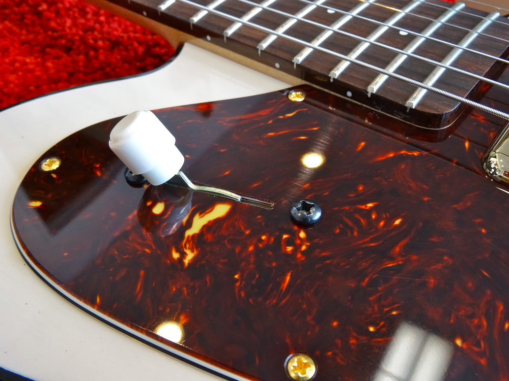 The vintage Tele style knob on the 3-way switch contrasts nicely with the deep tortoise pickguard.