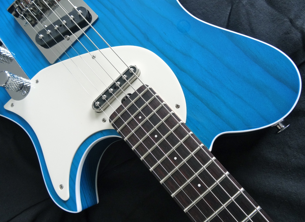 "The Porter T-90 pickups give it a ""thicker than tele"" sound with plenty of spank & jangle"