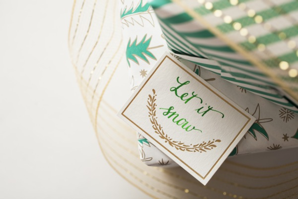 Green calligraphy by bedsidesign, gift tags by Smock  Photo Credit: Amelia Beamish for Smock