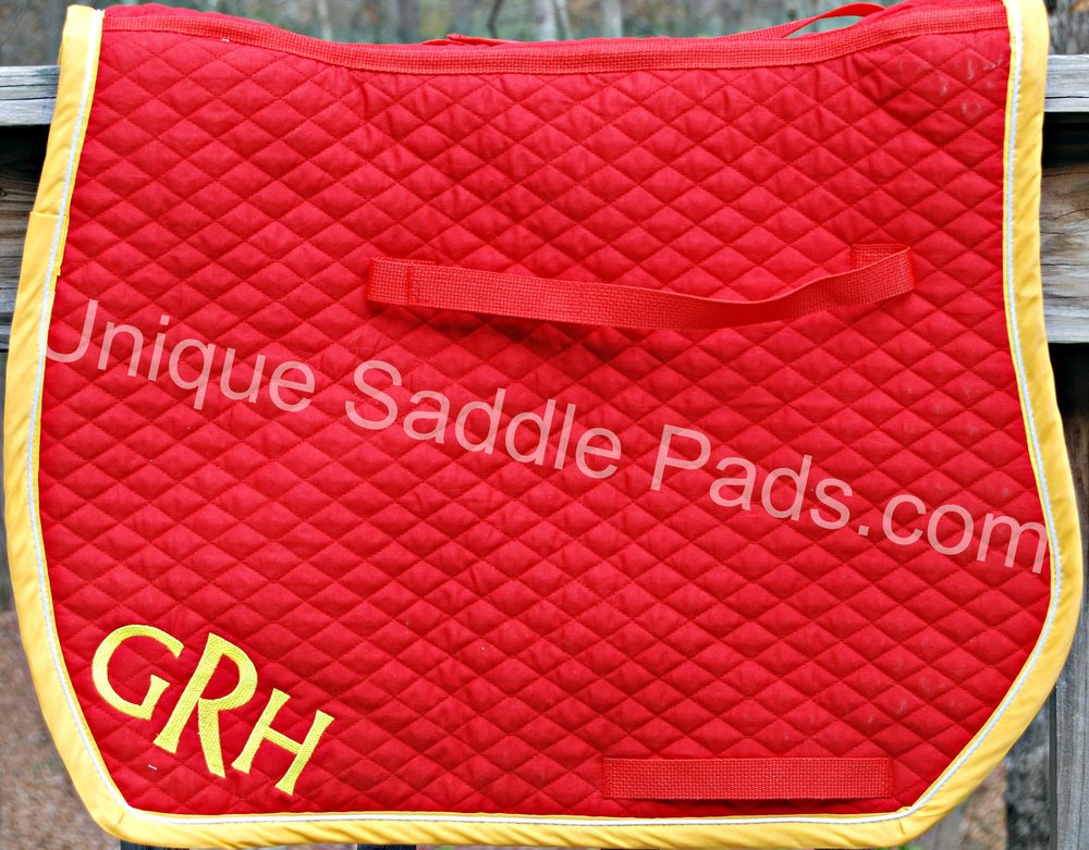 For example:   This saddle pad has a red body, athletic gold trim, white corded bling and an athletic gold monogram.