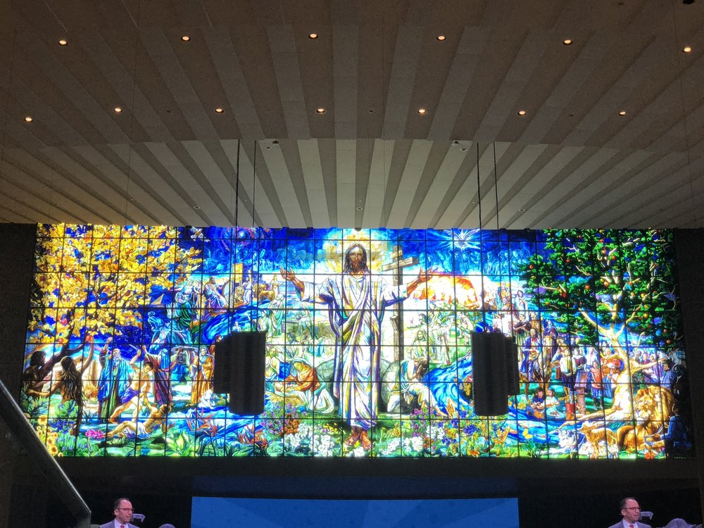 The stain glass window in the sanctuary at COR
