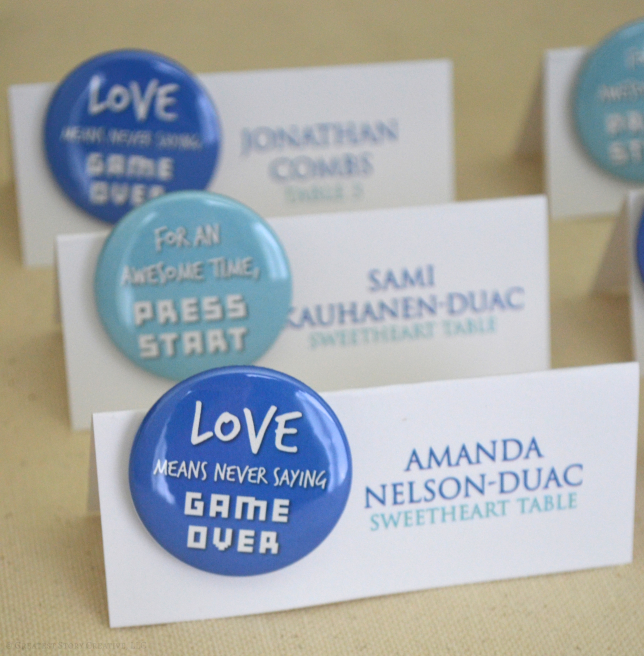 """Love Means Never Saying Game Over"" Button Escort Cards and Favors"